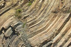 Bent hexagonal columns of volcanic origin at the Hong Kong Global Geopark in Hong Kong, China. Stock Photo
