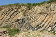 Bent hexagonal columns of volcanic origin at the Hong Kong Global Geopark in Hong Kong, China. Stock Photography