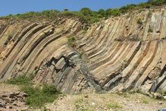 Bent hexagonal columns of volcanic origin at the Hong Kong Global Geopark in Hong Kong, China. stock photography