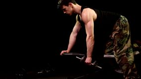 Bent-Over Row Exercise. Studio shot over black stock footage