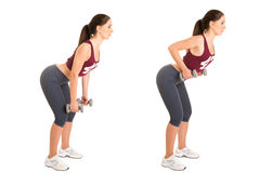 Bent Over Rows. Personal Trainer doing bent over rows for training her lats, isolated in white Royalty Free Stock Image