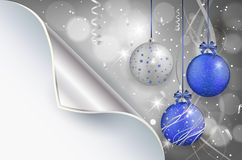 Bent paper and shiny christmas background with christmas balls Royalty Free Stock Photo