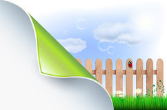 Bent paper and spring countryside with wooden fence Royalty Free Stock Image