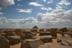 The Bent Pyramid on the horizon of the desert Stock Photos