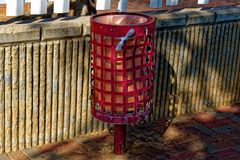 Bent and rusty red trash can stock photos