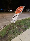 Bent street sign. Bent stop and right turn only traffic sign Stock Photo