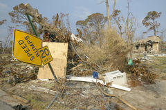 Bent street signs and debris in front of house heavily hit by Hurricane Ivan in Pensacola Florida Royalty Free Stock Photos