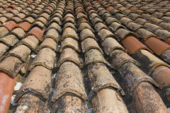 Bent tiles. A portion of roof of old-stile bent tiles repaired with new ones Royalty Free Stock Images