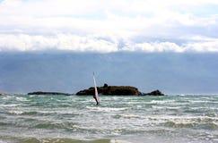 Bent Windsurfer on a sea near island Royalty Free Stock Photos