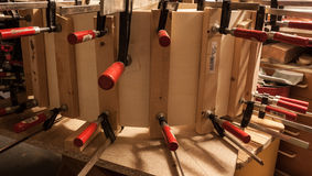 Bent wood fixed with clamps Royalty Free Stock Photos