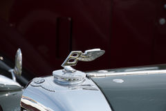 Bentley car logo. MANCHESTER UNITED KINGDOM - JULY 11 2015: Close up view of the Bently badge and hood ornament. July 2015 Stock Images