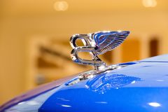 2015 Bentley Continental GT car emblem. GENEVA, SWITZERLAND - MARCH 4, 2015: Bentley emblem on the hood of a 2015 Bentley Continental GT at the 85th Royalty Free Stock Image
