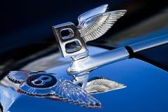 Bentley emblem. Emblem Bentley on a car cowl Stock Photos
