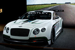 Bentley GT3 Race car. Side view with screen behind it Royalty Free Stock Photo
