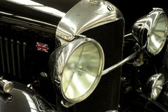 1930 Bentley 4.5liter 'Black Label'. CU detail of the grille and massive headlights of a pristine 1930 'Black Label' Bently 4.5 liter tourer Royalty Free Stock Images