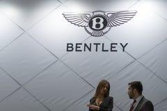 Bentley logo luxury carmaker with salesmen. Belgrade,Serbia - March 20,2016.Bentley logo luxury carmaker with salesmen on annual Belgrade car show 2016 Royalty Free Stock Photo