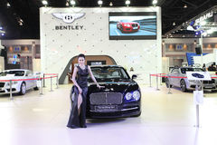 Bentley The new Flying Spur car with Unidentified model Royalty Free Stock Images