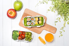 Bento box with different food, fresh veggies and fruits Royalty Free Stock Photos