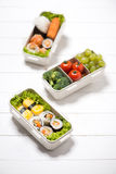 Bento box with different food, fresh veggies and fruits Royalty Free Stock Photo