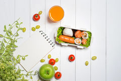 Bento box with different food, fresh veggies and fruits. Noteboo Stock Photography