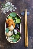 Japanese bento box lunch. Bento box with onigiri, prawns and vegetables royalty free stock photo