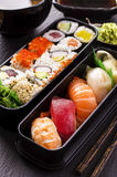 Bento Box with Sushi and Rolls Stock Images