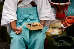 Bento Lunch in period costume. Japanese man in traditional clothes eating bento (boxed lunch) prior to the Ji-Dai Matsuri parade in Kyoto, Japan royalty free stock photos