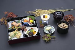 Bento and tray meal of Japanese style with rice, sushi and soy s Stock Photo