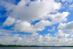 Bentota Ganga river, Sri Lanka. Summer landscape with white stormy clouds. Mangrove trees in the water. Big river in Asia. Beautif Stock Photo