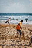 BENTOTA, SRI LANKA - APR 28: Teenagers play cricket with bat and Stock Image