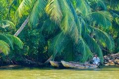 BENTOTA, SRI LANKA - JANUARY 25, 2016: a strong fisherman on his Stock Photos