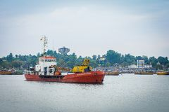 Small cargo ship in the port of Sri Lanka royalty free stock photo