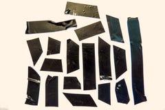 Benutzte schwarze Band-Stücke Lizenzfreies Stockfoto