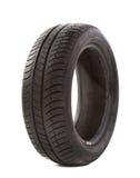 Benutzter Reifen auf Weiß Stockfotografie