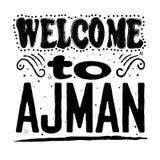 Benvenuto ad Ajman - grande iscrizione della mano immagine stock