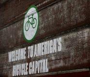 Benvenuto al segno del capitale della bicicletta dell'America Immagini Stock Libere da Diritti