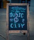 Benvenuto al segno della città di musica Fotografia Stock