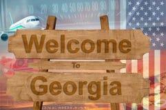 Benvenuto allo stato di Georgia nel segno su legno, tema di U.S.A. del travell Fotografia Stock