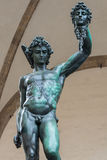 Benvenuto Cellini's Perseo with the head of Medusa. Famous bronze statue by Benvenuto Cellini Perseus with the severed head of Medusa placed in Piazza della Stock Photo