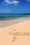 Benvenuto di parola sulla spiaggia Immagini Stock