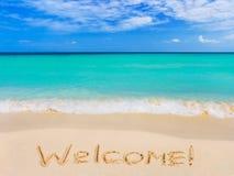 Benvenuto di parola sulla spiaggia Immagine Stock