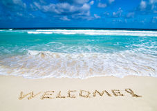 Benvenuto scritto in spiaggia Immagini Stock