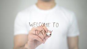 Benvenuto in Turchia, scrittura dell'uomo sullo schermo trasparente Fotografie Stock