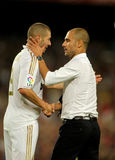 Benzema and Guardiola shake hands Stock Image
