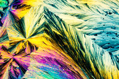 Benzoic acid crystals in polarized light Stock Photography
