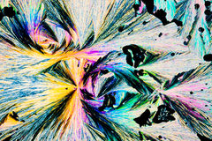 Benzoic acid crystals in polarized light Royalty Free Stock Image