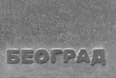 Beograd. Word Beograd engraved on old granite stone stock photography