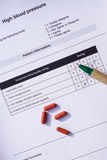 Beoordeling van het hoge bloeddruk de persoonlijke blad Royalty-vrije Stock Foto's