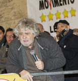 Beppe Grillo portrait with microphone stock image