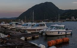 Beppu Harbor with Boats and Mountain in the Background in the evening. Beppu, Oita Prefecture, Japan, Asia royalty free stock photo
